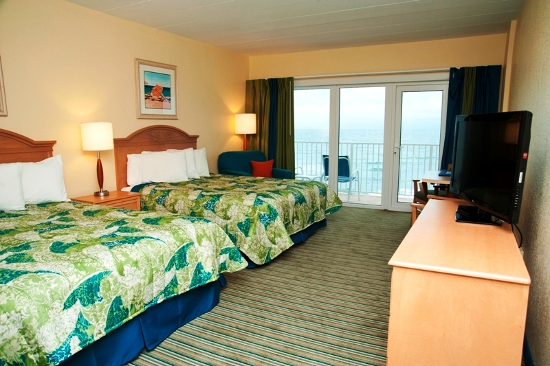 TV and two beds with an ocean view at Sea Ranch