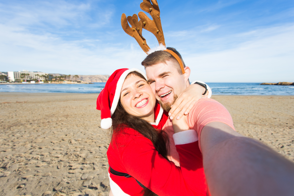 Couple on the beach for Christmas in North Carolina