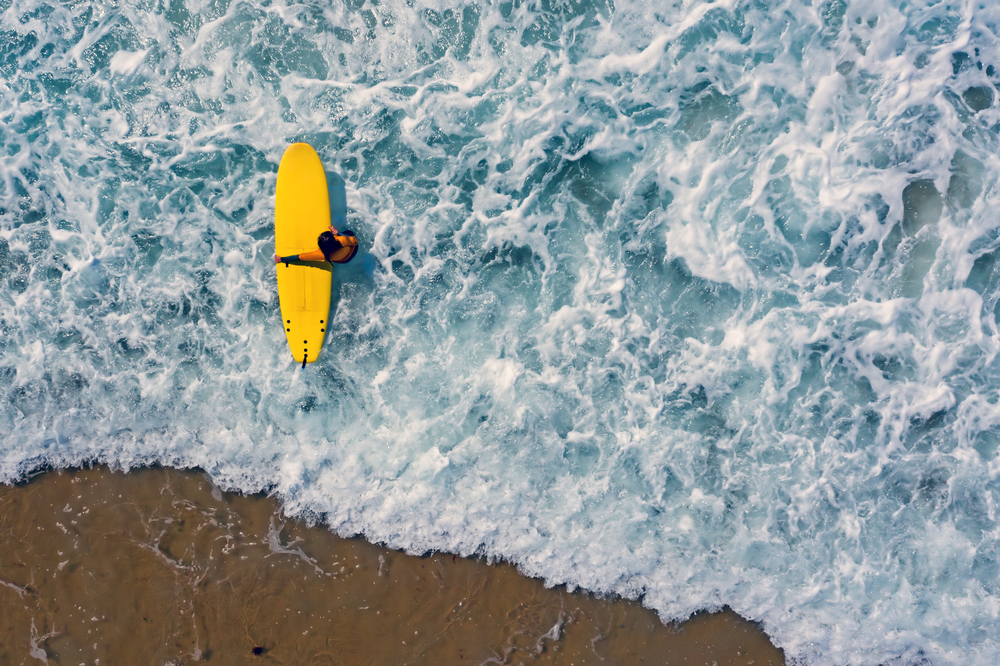 Outer Banks surfing aerial view of yellow board
