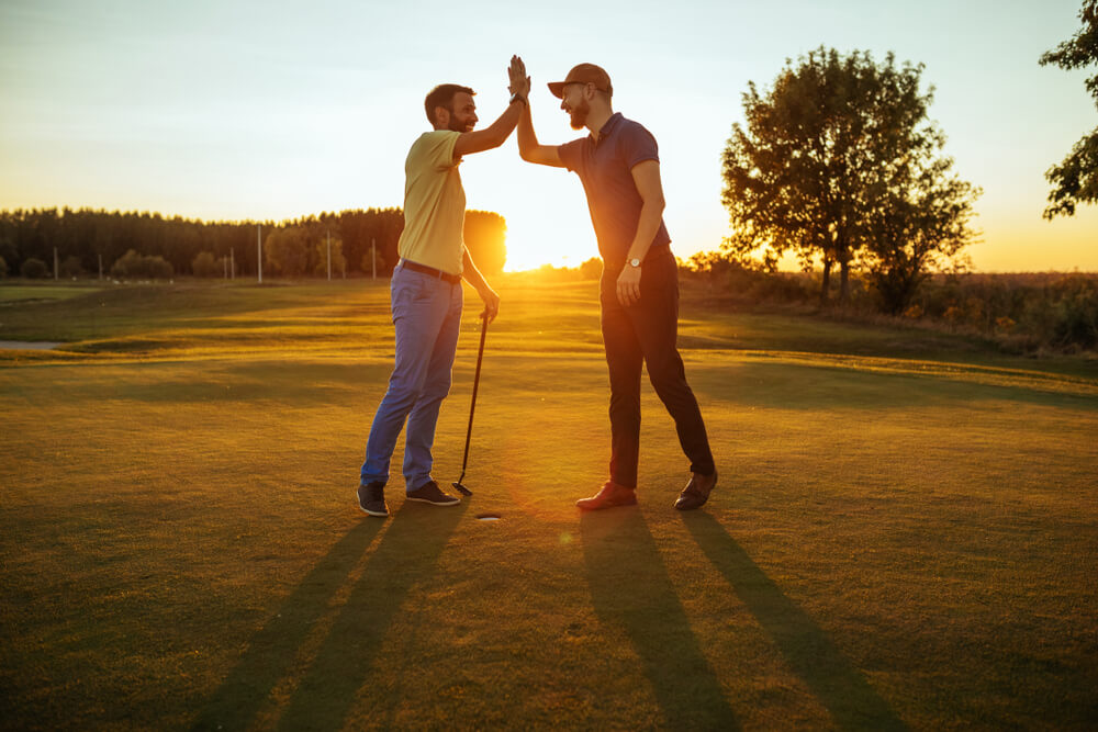 Picture of friends enjoying Outer Banks golf courses.