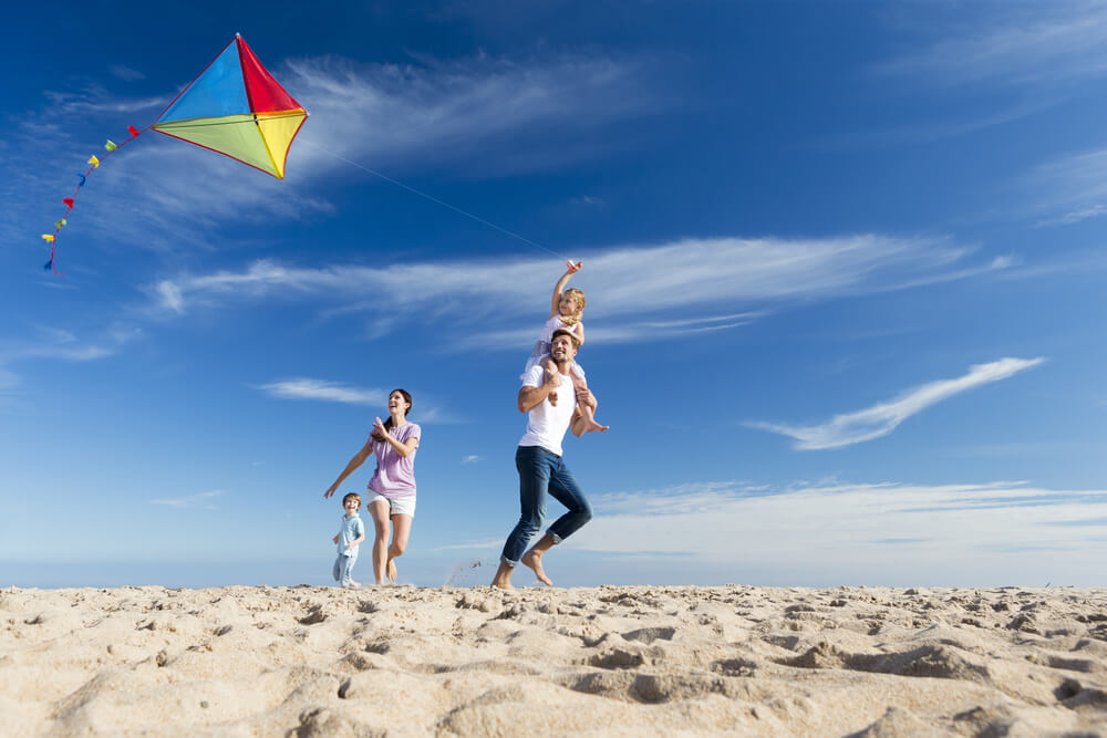 A photo of a family flying a kite, one of the many things to do in Kill Devil Hills NC