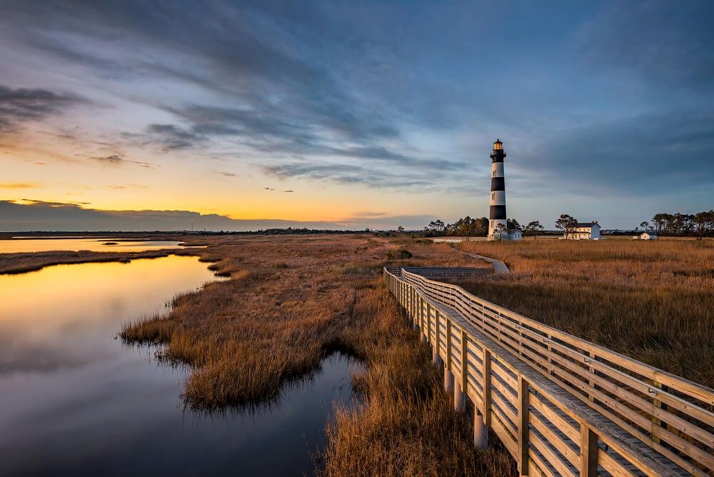 A photo of a lighthouse in one of the stunning towns in Outer Banks, NC.