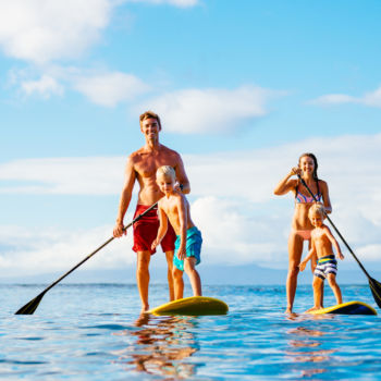 Stand up paddle boarding family that is staying at the Sea Ranch Resort