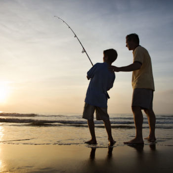 Picture of family enjoying the Outer Banks fishing scene.